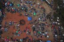 Central American migrants gather in an area designated for them to set up their tents in Tijuana, Mexico, Nov. 21, 2018.