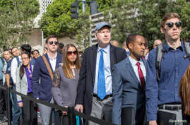 FILE - Job seekers line up at TechFair in Los Angeles, California, March 8, 2018.