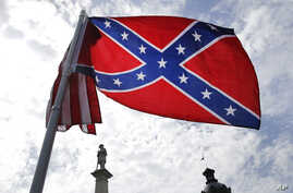 A protester waves a Confederate battle flag in front of the South Carolina statehouse, July 9, 2015, in Columbia, South Carolina.