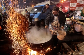 Protesters prepare food in tented camp at central Independence Square, Kyiv, Ukraine, Dec. 7, 2013.