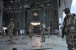 Pakistani para-military soldiers stand alert after a deadly suicide attack at the shrine of famous Sufi Lal Shahbaz Qalandar in Sehwan, Pakistan, Feb. 16, 2017.