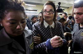 FILE - Guatemala's former Vice-President Roxana Baldetti arrives to a hearing at the Supreme Court of Justice in Guatemala City, Guatemala, March 28, 2016, on charges of conspiracy, customs fraud and bribery charges.