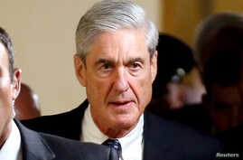 FILE - Special Counsel Robert Mueller departs after briefing members of the U.S. Senate on his investigation into potential collusion between Russia and the Trump campaign on Capitol Hill in Washington.