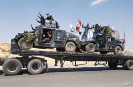 A handout picture released by the Iraqi Federal Police on Aug. 15, 2017, shows Iraqi armored units headed for the town of Tal Afar, the main remaining Islamic State stronghold in the northern part of the country. Iraqi warplanes carried out airstrike