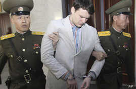 American student Otto Warmbier, center, is escorted at the Supreme Court in Pyongyang, North Korea, Wednesday, March 16, 2016. Warmbier was sentenced to 15 years in prison with hard labor on Wednesday.