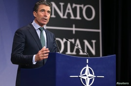 FILE - NATO Secretary General Anders Fogh Rasmussen addresses a news conference during a NATO foreign ministers meeting in Brussels April 1, 2014.
