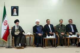 Iranian Supreme Leader Ayatollah Ali Khamenei, far left, meets with President Hassan Rouhani, second from left, and other members of the president's Cabinet on Aug. 29, 2018.