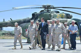Syria's President Bashar al-Assad visits a Russian air base at Hmeymim, in western Syria in this handout picture posted on SANA, June 27, 2017.