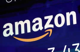 FILE - In this July 27, 2018 file photo, the logo for Amazon is displayed on a screen at the Nasdaq MarketSite.