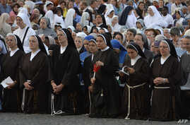 Nuns attend a mass at Saint John's Lateran Basilica in Rome, Italy, June 4, 2015.