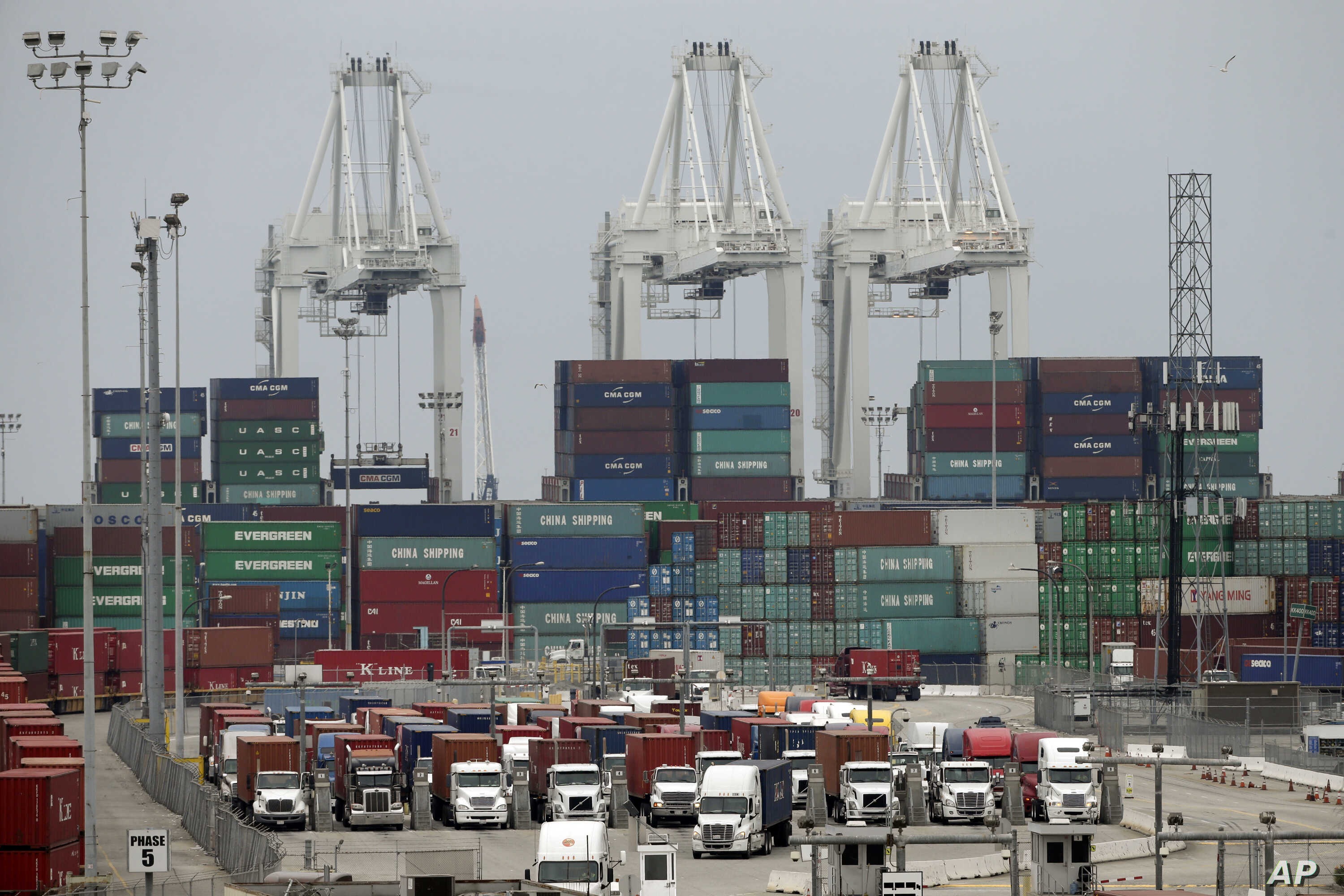 Cargo trucks wait in line at the Port of Long Beach, in Long Beach, Calif., Feb. 17, 2015.