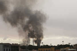 Black smoke billows above areas where pro-government forces and Shura Council of Libyan Revolutionaries are battling in Benghazi, Dec. 11, 2014.