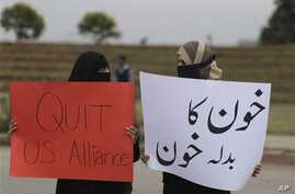 Pakistani women protest NATO helicopters attacks on Pakistani troops, in Islamabad, Pakistan, Dec. 1, 2011.