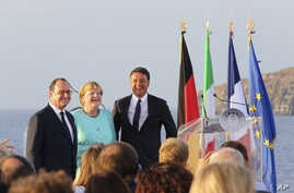 FILE - Italian Premier Matteo Renzi, right, French President Francois Hollande, left, and German Chancellor Angela Merkel stand on the deck of an Italian aircraft carrier off of Italy, Aug. 22, 2016. The leaders of Italy, France and Germany are watch...