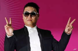 """South Korean rapper PSY poses during a news conference for his concert """"Happening"""" in Seoul, South Korea, April 13, 2013."""