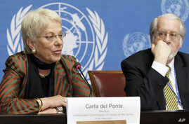 FILE - Switzerland's Carla del Ponte, left, a member of the Commission of Inquiry on Syria, sitting next to Brazilian Paulo Pinheiro, right, Chairperson of the Commission, as she speaks to the media during a press conference after the session of the