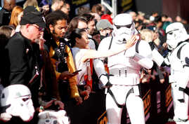 "FILE - A fan takes a selfie with a Stormtrooper at the premiere for the movie ""Solo: A Star Wars Story"" in Los Angeles, California, U.S., May 10, 2018."
