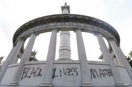 "The words ""Black Lives Matter"" spray painted on a monument to former Confederate President Jefferson Davis in Richmond, Va., June 25, 2015."