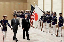 U.S. Vice President Mike Pence, third from left, and Japan's Prime Minister Shinzo Abe review an honor guard before their meeting at Abe's official residence in Tokyo Wednesday, Feb. 7, 2018.
