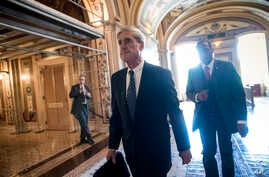 FILE - Special counsel Robert Mueller departs after a closed-door meeting with members of the Senate Judiciary Committee about Russian meddling in the election and possible connection to the Trump campaign, at the Capitol in Washington, June 21, 2017...