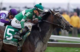 Eventual winner Exaggerator with Kent Desormeaux aboard moves past Nyquist and jockey Mario Gutierrez during the 141st Preakness Stakes horse race at Pimlico Race Course in Baltimore, May 21, 2016.