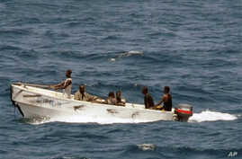 In this U.S. Navy photo, pirates leave the Ukrainian merchant vessel MV Faina for Somalia's shore Wednesday, Oct. 8, 2008 while under observation by a U.S. Navy ship. The MV Faina, which was carrying a cargo of Ukrainian T-72 tanks and related milita