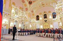 FILE In this file photo taken on Tuesday, Sept. 11, 2012, President Vladimir Putin, foreground left, speaks as he meets with the national paralympic team after they returned from the Paralympic Games 2012 in London, in Moscow's Kremlin, Russia. The e