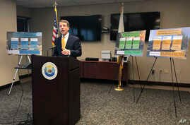 California Insurance Commissioner Dave Jones talks about the costs of recent wildfires during a news conference in Sacramento, California.