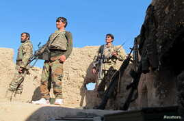 Afghan National Army (ANA) soldiers stand at an outpost in Helmand province, Dec. 20, 2015.