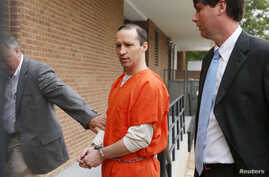James Everett Dutschke, flanked by U.S. Marshals, arrives for a sentencing hearing at the United State Federal Building in Aberdeen, Mississippi May 13, 2014