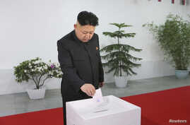 FILE - North Korean leader Kim Jong Un visits the Kim Il Sung University of Politics to take part in the election of a deputy to the Supreme People's Assembly at sub-constituency No. 43 of Constituency No. 105, March 9, 2014.