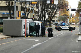 Edmonton Police investigate at the scene where a man hit pedestrians then flipped the U-Haul truck he was driving, in Edmonton, Alberta, Canada, Oct. 1, 2017.