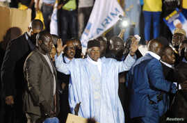 Senegal's former President Abdoulaye Wade greets a crowd upon his arrival in Dakar April 26, 2014.