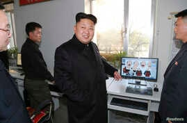 In this undated photo released by North Korea's Korean Central News Agency,  North Korean leader Kim Jong Un visits the Korean April 26 Cartoon Film Studio.