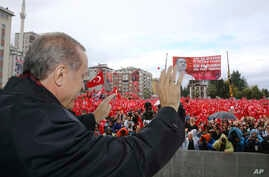 "Turkish President Recep Tayyip Erdogan salutes the crowd of supporters in his hometown of Rize, on the Black Sea coast of Turkey, Oct. 15, 2016. Erdogan said Turkey was moving into Dabiq, Syria, and would declare a ""terror-free safe zone"" in the regi"