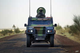 French soldiers in a British made armored car lead a  French supply convoy near Hambori, northern Mali, on the road to Gao, February 4, 2013.