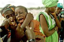 FILE - Health organizations have launched a vaccination campaign to curb the spread of meningitis in Guinea. Here, a youngster cries as he's inoculated in Senegal near the border with Guinea.