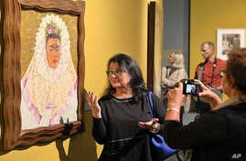 Guests attend a preview of a new exhibition featuring works by Mexican artists Frida Kahlo and Diego Rivera, in Poznan, Poland, Sept. 26, 2017.