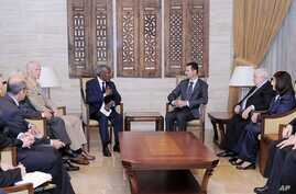 UN-Arab League Joint Special Envoy for Syria Kofi Annan, center left, and Syrian President Bashar Assad, center right, meeting in Damascus, Syria, Tuesday, May 29, 2012.