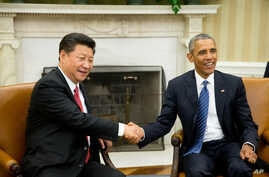 President Barack Obama shakes hands with Chinese President Xi Jinping during their meeting in the Oval Office of the White House in Washington, Sept. 25, 2015.