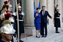 France's President Emmanuel Macron welcomes Polish Prime Minister Beata Szydlo, center left, prior to a meeting, at the Elysee Palace, in Paris, Nov. 23, 2017.