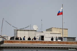 People are seen on the rooftop at the Consulate General of Russia in San Francisco, California, Sept.  2, 2017.
