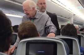 Former president Jimmy Carter shakes hands with every passanger on a recent flight from Atlanta, Georgia, to Washington, D.C. (Twitter - @UPROXX)