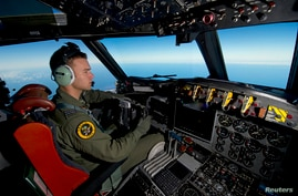Royal Australian Air Force (RAAF) pilot, Flight Lieutenant Russell Adams from 10 Squadron, steers his AP-3C Orion over the Southern Indian Ocean during the search for missing Malaysian Airlines flight MH370, March 20, 2014.