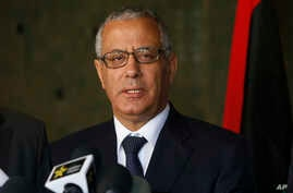 FILE - In this Oct. 8, 2013 file photo, Libyan's Prime Minister Ali Zidan speaks to the media during a press conference in Rabat, Morocco