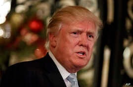 President-elect Donald Trump speaks to reporters at Mar-a-Lago, Dec. 28, 2016, in Palm Beach, Florida.
