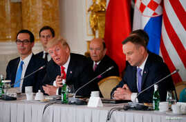 U.S. President Donald Trump talks to Polish President Andrzej Duda as U.S. Secretary of the Treasury Steven Mnuchin, White House Senior Advisor Jared Kushner and U.S. Secretary of Commerce Wilbur Ross listen during the Three Seas Initiative Summit in