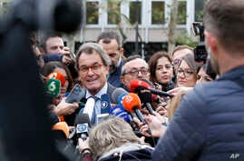 FILE - Artur Mas, a former President of Catalonia, talks to journalists outside the national court in Madrid, Spain, Nov. 2, 2017.