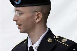 Army Pfc. Bradley Manning is escorted out of a courthouse after receiving a verdict in his court-martial, in Fort Meade, Maryland, July 2013.