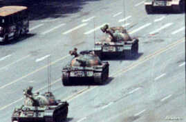 FILE - A Beijing citizen stands in front of tanks on the Avenue of Eternal Peace, June 5, 1989.